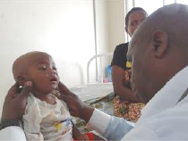 An infant receiving care at the health center